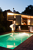 Architect-designed house and pool illuminated at twilight