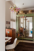Old cupboard with mirrored doors in vintage-style teenager's bedroom