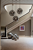 Mirrored ceiling lamps and decorative spheres in classic foyer