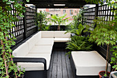 Spacious, modern outdoor sofa on roof terrace