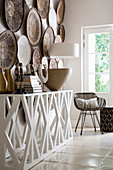 Decorative wall plates above white console table