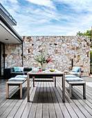 Table with benches on terrace with wooden deck