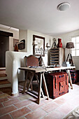 Desk with armchair in front of stairs in the hallway area of ??a country house