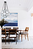 Dining room with hanging lamp and posters on the wall