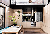 Modern kitchen with light wooden fronts and skylight