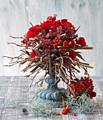Bouquet of red begonias, orchids and rowan berries