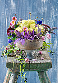 Bowl of clematis, roses and Japanese anemones