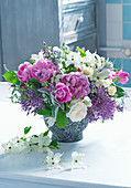 Bouquet of peonies, roses, flowering dogwood and alliums