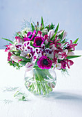 Bouquet of moth orchids, tulips, anemones, nerine lilies and love-in-a-mist