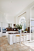 Bright open kitchen with counter and arched windows