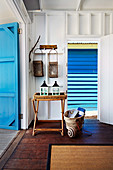 Beach house in blue and white with beach utensils and decoration