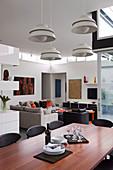 Modern open living room in designer style with dark furniture