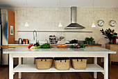 Long table with storage baskets as a kitchen island