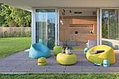 Modern garden furniture in lime-green and pale blue on terrace