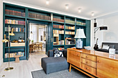 Blue bookcase and open double doors