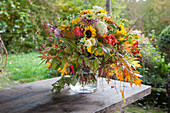 Autumn bouquet of hydrangeas, chrysanthemums, sunflowers and oak leaves