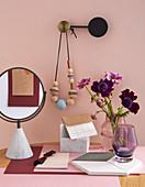 Feminine still-life arrangement in shades of pink and purple
