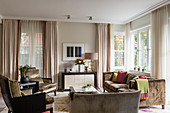 Furniture with velvet upholstery in earthy shades in large, luxurious living room