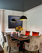 Velvet chairs and panelled walls in luxurious dining room