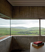 Continuous ribbon window running around corner with panoramic view of landscape