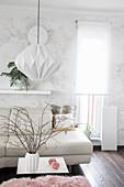 Handmade lamp made from folded wallpaper in bright interior
