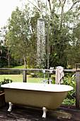 Outdoor bathtub with rain shower