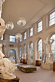 A collection of large plaster casts in the orangery with disco balls
