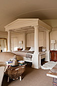 Oak painted off-white four poster bed resembling a classical temple