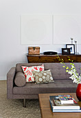 Two white pictures on white wall in the living room in shades of brown