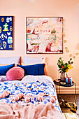 Bedroom in shades of pink and blue with tassel plaid, abstract murals and Christmas decorations