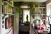 Collection of vases on shelves in small country-house kitchen