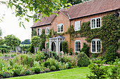 Renovated English country house with Gothic lattice windows