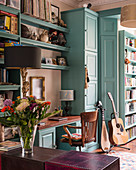 Turquoise fitted cupboards in classic living room