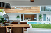 View from the dining table onto the pool in the modern courtyard area of ??an architect's house