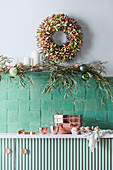 Christmas decoration over green tiles and vanity in the kitchen