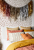 Tinsel over double bed in the bedroom