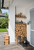 Firewood stacked in niche on terrace