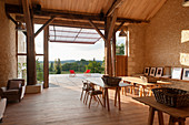 Barn converted into workshop studio with wooden deck and view of landscape