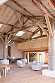 Renovated barn converted into workshop studio with wooden gallery