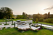 Stone steps leading to swimming pool in garden with view of the Périgord Vert landscape