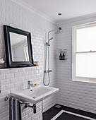 Classic black-and-white bathroom with subway wall tiles and mosaic floor