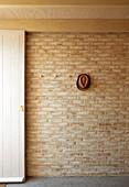 Brick wall in foyer