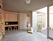 Wooden fitted furnishings in child's bedroom with access to terrace