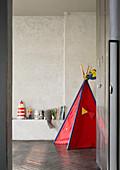 Wigwam in minimalist child's bedroom in shades of grey