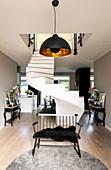 Free-standing, half-turn winder stairs in open-plan interior