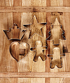Festive pastry cutters on wooden surface