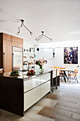 Kitchen island in front of dining area in open-plan interior