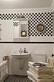 Black-and-white bathroom with chequered wall tiles