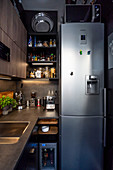 Tall fridge-freezer in small, grey, masculine kitchen