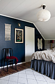 Bohemian bedroom with dark blue wall